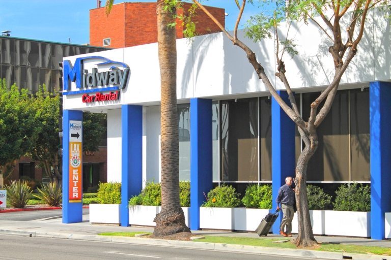 Close up side view of Midway Car Rental's LAX location